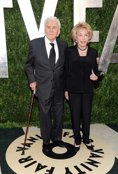 Actor Kirk Douglas, left, and wife Anne Douglas arrive at the 2013 Vanity Fair Oscars Viewing and Af