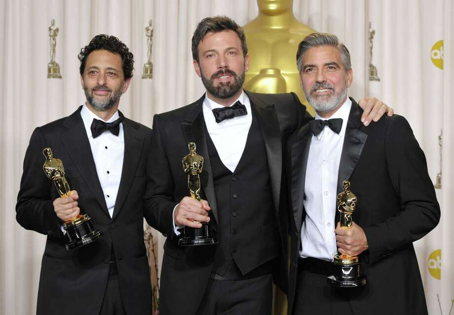 "Grant Heslov, from left, Ben Affleck, and George Clooney pose with their award for best picture for ""Argo"" during the Oscars at the Dolby Theatre on Sunday Feb. 24, 2013, in Los Angeles. (Photo by John Shearer/Invision/AP) Photo: John Shearer"