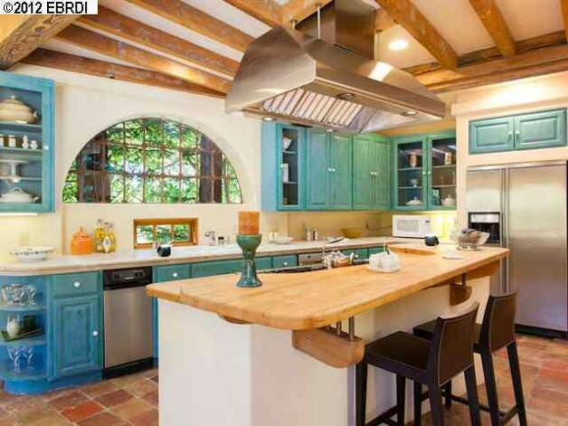 The blue cabinets bring out the French country style