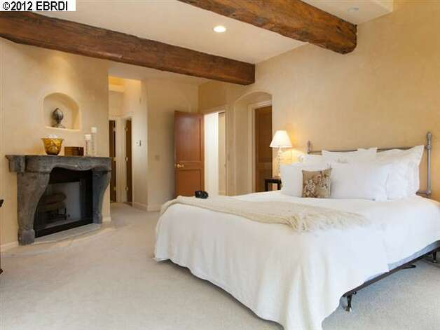 The master suite also has a fireplace with stone from the Burgundy region of France