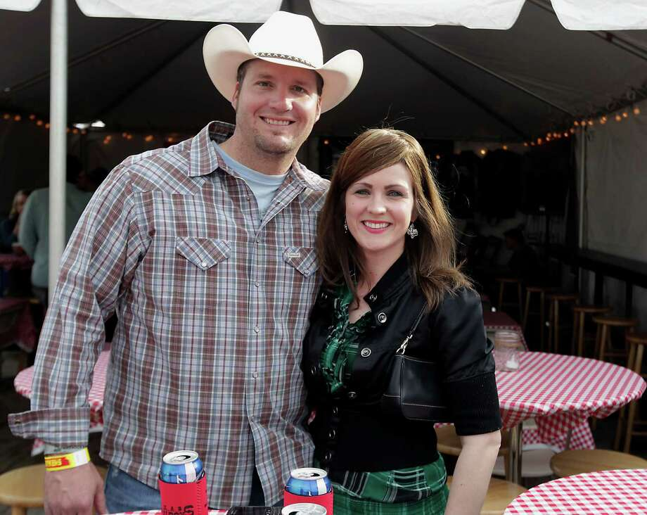 Jerry Kellen left, and his fiancée Chelsea Holland during the Houston Livestock Show and Rodeo Worldís Championship Bar-B-Que Contest at Reliant Park Friday, Feb. 22, 2013, in Houston. Photo: James Nielsen, Houston Chronicle / © 2013  Houston Chronicle