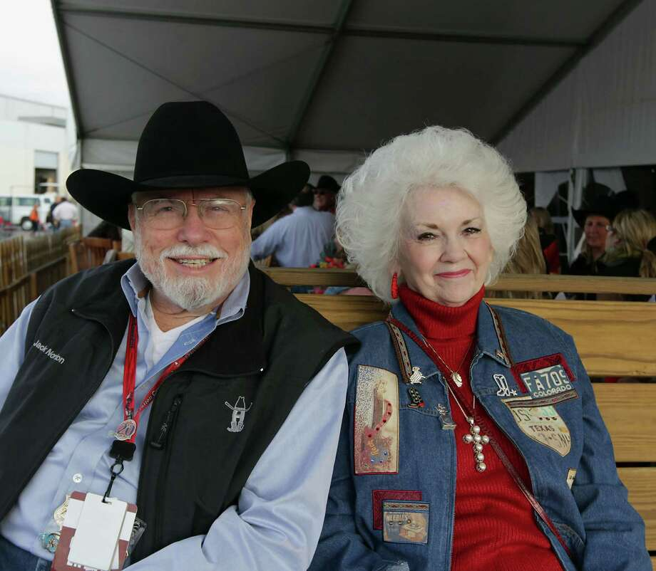 Jack Norton left, and Linda Cohen during the Houston Livestock Show and Rodeo WorldâÄôs Championship Bar-B-Que Contest at Reliant Park Friday, Feb. 22, 2013, in Houston. Photo: James Nielsen, Houston Chronicle / © 2013  Houston Chronicle