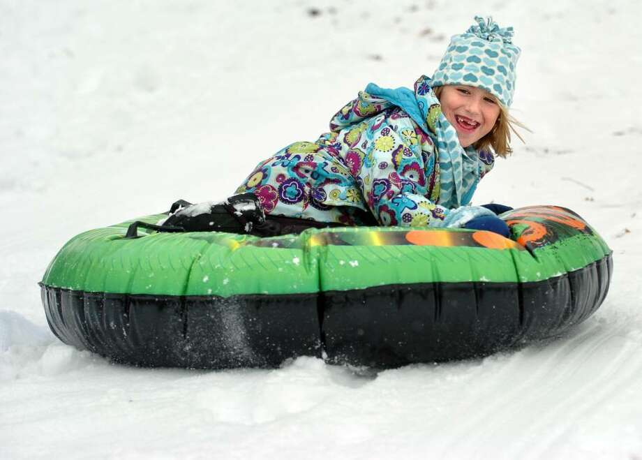 Six-year-old Morgan Rahn, of Orange, sleds down the hill Thursday at the Ansonia Nature Center during their Winter Holiday Nature Days program. Photo: Autumn Driscoll / Connecticut Post