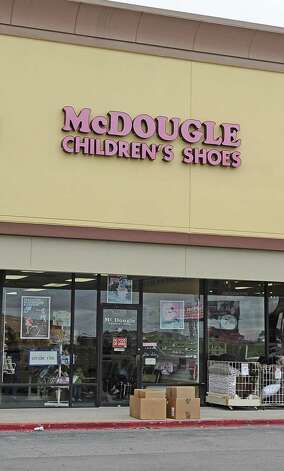 "McDougle Children's Shoes       Chrystal Reeves Hilderbrand of Jasper: ""As a child, I enjoyed shoe shopping at McDougles Shoes in the Gaylynn Shopping Center on 11th Street, now in the Target center!""    Randy Edwards/The Enterprise"