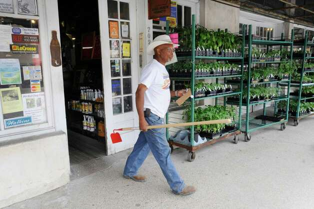 B.T. Riggins of Orange, leaves the Farmers Mercantile in Orange with a new gardening hoe for some weekend project work. Farmers Mercantile has been serving the community since 1928 and is a throwback to an earlier time, but it's more than just an archaic curiosity -- it's still very much a vital business. Valentino Mauricio/The Enterprise Photo: Valentino Mauricio / Beaumont