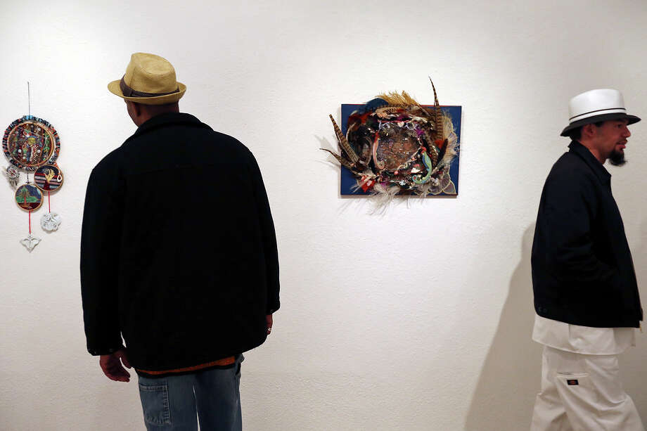 """Charles Patterson (left) and Juan Gonzalez look at art by Christinah Rose Barnett part of """"My Heart Grew Into Its Fingers While My Mind Fumbled At The Mouth"""" exhibit at Fl!ght Gallery during Second Saturday in the South Flores Arts District Saturday Feb. 9, 2013. Photo: Edward A. Ornelas, San Antonio Express-News / © 2013 San Antonio Express-News"""