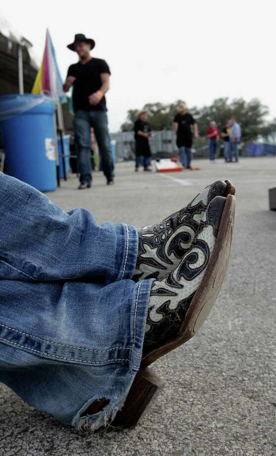 Andrea Lee crosses her boots while relaxing during the Houston Livestock Show and Rodeo WorldâÄôs Championship Bar-B-Que Contest at Reliant Park Friday, Feb. 22, 2013, in Houston. Photo: James Nielsen, Houston Chronicle / © 2013  Houston Chronicle