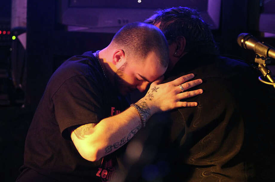 Miles Zenteno Towns, son of Norma Zenteno, embraces Artie Villasenor, family friend, after playing together during the Norma Zenteno Benefit and Tribute Concert at SRO's Sports Bar & Cafe on Sunday, Feb. 24, 2013, in Houston.  Norma Zenteno lost her battle with breast cancer on Friday. Photo: Mayra Beltran, Houston Chronicle / © 2013 Houston Chronicle