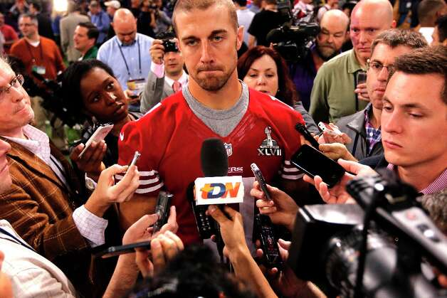 49er quarterback Alex Smith, 11 talks with reporters as Media Day gets underway at the Mercedes-Benz Superdome the site of this year's Superbowl between the San Francisco 49ers and the Baltimore Ravens in New Orleans, La. on Tues. Jan. 29, 2013. Photo: Michael Macor, The Chronicle / ONLINE_YES
