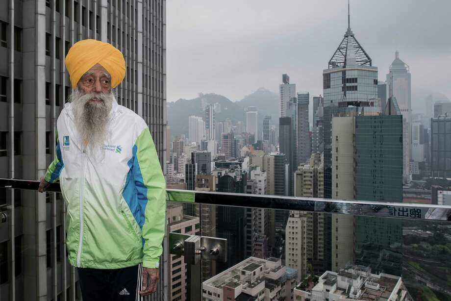 "Indian-born British national Fauja Singh looks on during a press conference in Hong Kong on February 21, 2013.  The 101-year-old Sikh regarded as the world's oldest marathon runner said he was ""hurt"" over his retirement plan as he feared people will forget him, ahead of his last race to take place in Hong Kong on February 24.  AFP PHOTO / Philippe LopezPHILIPPE LOPEZ/AFP/Getty Images Photo: PHILIPPE LOPEZ, AFP/Getty Images / F AFP"