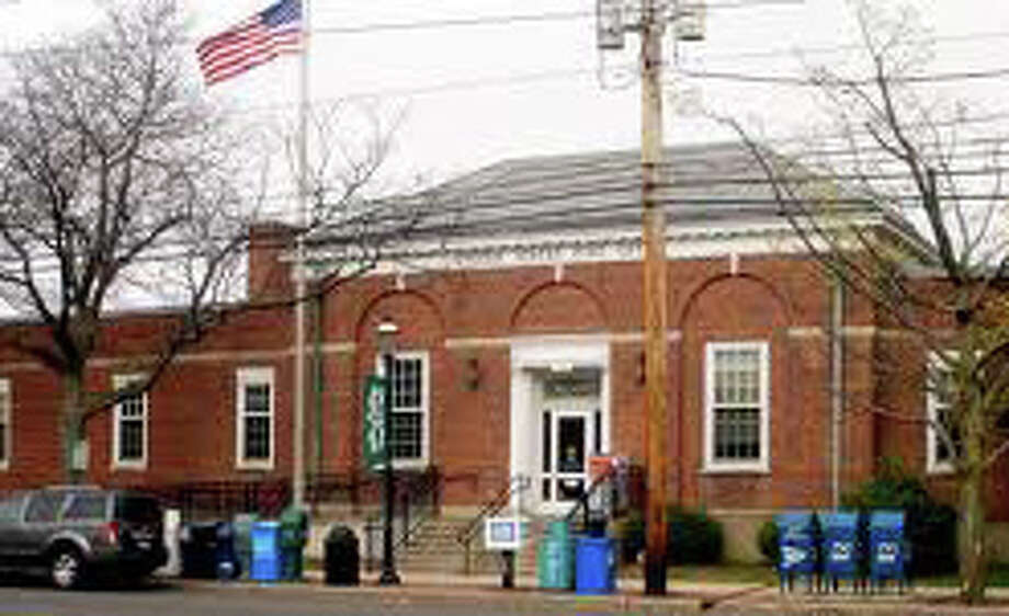 The new owners of the former downtown Post Office were denied their request to reduce the amount of required parking to accommodate a restaurant plan in the structure, but plan to submit a revised plan. FAIRFIELD CITIZEN, CT 2/25/13 Photo: File Photo / Fairfield Citizen