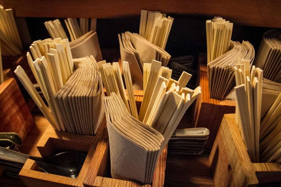Yet the style is exacting, from the 18-seat Douglas fir counter to the rusted stools and the rough wood boxes on the tables that house the chopsticks, spoons and brown paper napkins.