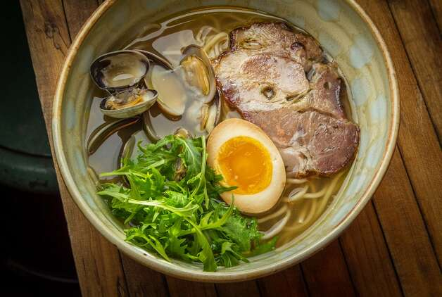 Jaksich's passion is on display with the shoyu Meyer lemon ramen ($14), topped with a spit-roasted slice of pork, a marinated half egg with a still-runny center, broccoli rabe and a small fist of mizuna. If you take the time to stop and smell what's in the bowl, you can detect the smoky earthiness of the meat, the sweet perfume of the citrus and the peppery nuances of greens that intensify as they warm in the hot, rich broth.(Pictured: The Shio ramen with manila clams, spit-roasted pork, marinated egg, and mizuna)