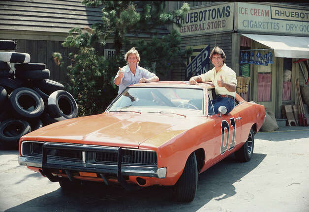 "Coy and Vance Duke's classic Dodge Charger, The General Lee, was a high-flying stunt car in the 1980s series, ""The Dukes of Hazzard."" Between 250-350 copies of the car were reportedly trashed while filming the series. Photo: CBS Photo Archive, Getty Images / 2005 CBS WORLDWIDE INC."