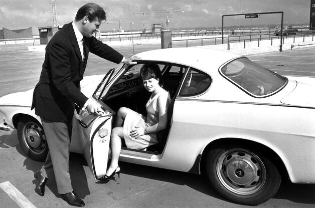 "Roger Moore portrayed Simon Templar in ""The Saint,"" where he famously drove a white 1962 Volvo P-1800 sports car. Photo: L. Trievnor, Getty Images / Hulton Archive"