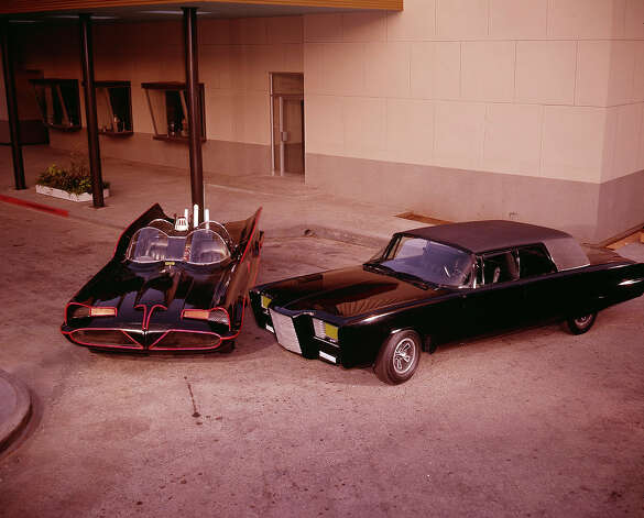 "Bruce Lee, as Kato, drove the ""Black Beauty,"" pictured right,  in the television version of ""The Green Hornet."" The car was a modified 1966 Chrysler Imperials chock full of crime-fighting gadgets. Photo: ABC Photo Archives, Getty Images / 2011 American Broadcasting Companies, Inc."