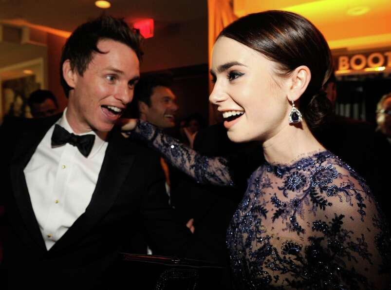Eddie Redmayne and Lily Collins attend the 2013 Vanity Fair Oscar Party hosted by Graydon Carter at