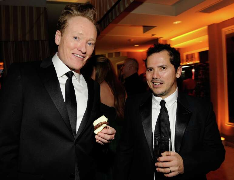 Conan O'Brien and John Leguizamo attend the 2013 Vanity Fair Oscar Party hosted by Graydon Carter at