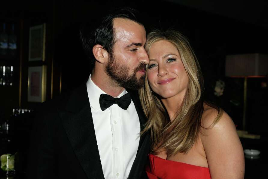 Actors Justin Theroux (L) and Jennifer Aniston attend the 2013 Vanity Fair Oscar Party hosted by Gra
