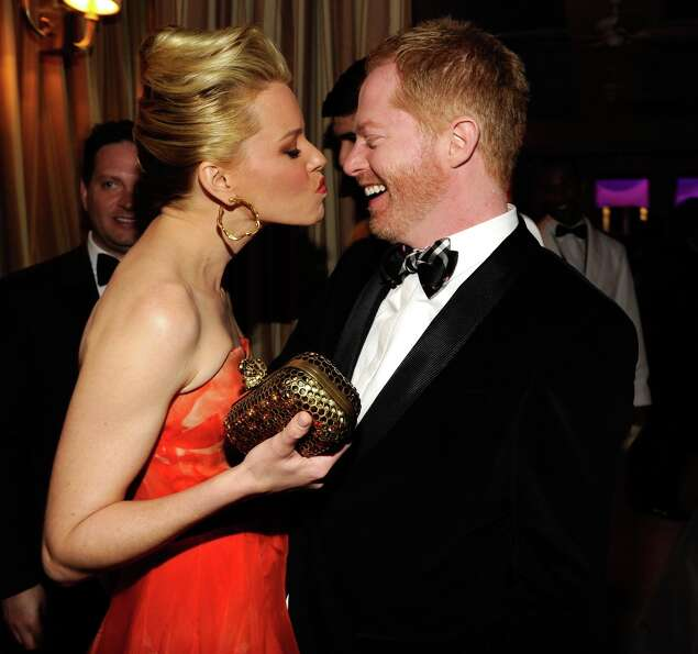 Elizabeth Banks and Jesse Tyler Ferguson attend the 2013 Vanity Fair Oscar Party hosted by Graydon C