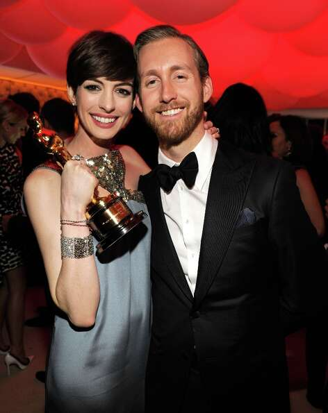 Anne Hathaway and Adam Shulman attend the 2013 Vanity Fair Oscar Party hosted by Graydon Carter at S