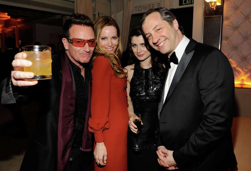 Singer Bono, his daughter, actress Eve Hewson, actress Leslie Mann, and director Judd Apatow attends