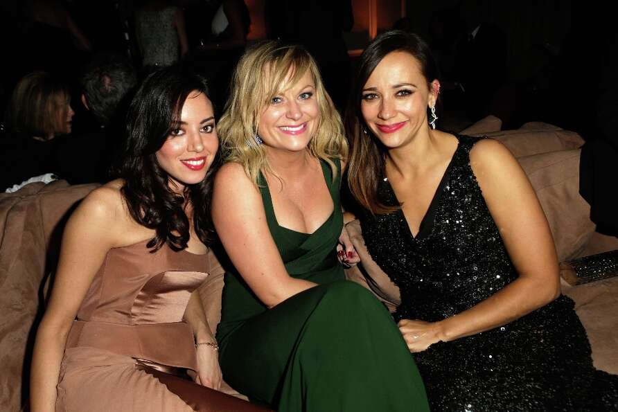 (L-R) Actress Aubrey Plaza, Amy Poehler, and Rashida Jones attend the 2013 Vanity Fair Oscar Party h