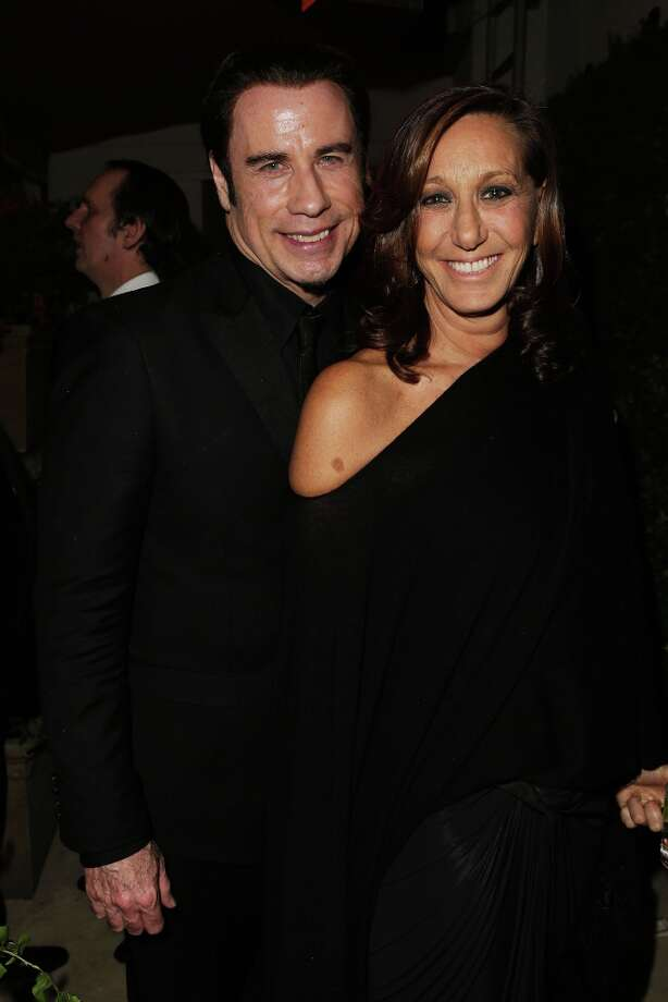 Actor John Travolta (L) and designer Donna Karan attend the 2013 Vanity Fair Oscar Party hosted by Graydon Carter at Sunset Tower on February 24, 2013 in West Hollywood, California. Photo: Jeff Vespa/VF13, WireImage / 2013 Jeff Vespa/VF13