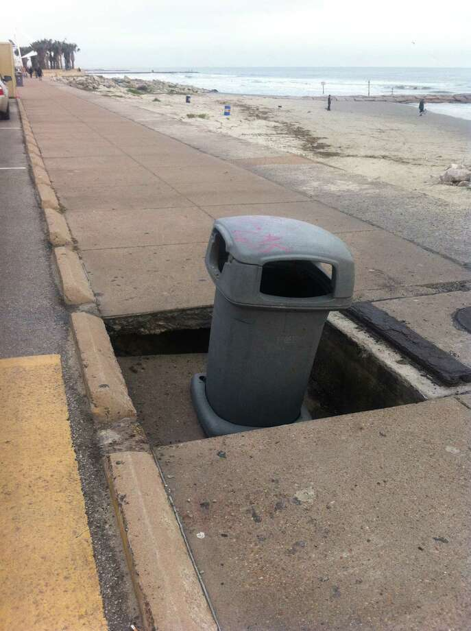 Galveston County work crews have erected barricades around a 3-foot-by-3-foot section of the Galveston Seawall sidewalk that has collapsed. County work crews plan to immediately repair the sinkhole, a Galveston city official said. Photo: City Of Galveston