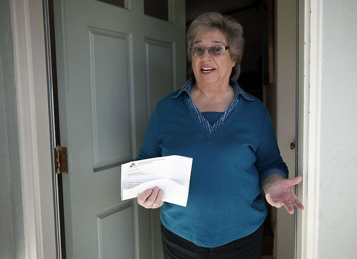 Retired school teacher Marie Benedetto, at her home in San Francisco, Calif., on Thursday Feb. 21 2013, holding the letter from CalPERS informing her of the 85 percent increase in long-term care insurance.