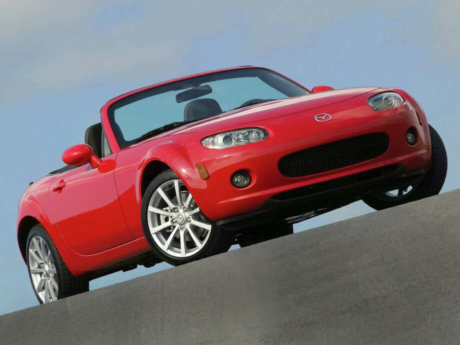 "Convertible: 2005-2010 Mazda MiataWhat Edmunds said: ""With its ultra-responsive and communicative steering, an exuberant engine and a manual transmission with short, precise throws and an easy clutch, Mazda's little two-seater wins over even those who don't know a camshaft from a crankshaft.""Source: Edmunds Photo: Ford / © 2007 Ford Motor Company"