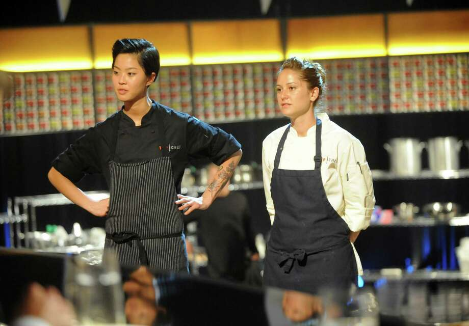 "This image released by Bravo shows chef contestants Kristen Kish, left, and Brooke Williamson in a scene from ""Top Chef: Seattle.""  Kish and Williamson are finalists in the cooking competition series airing Wednesdays at 10 p.m. EST on Bravo. (AP Photo/Bravo, David Moir) Photo: David Moir, Associated Press / Bravo"
