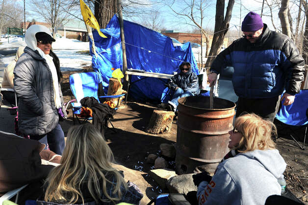Striking health care workers sit around a fire in a makeshift strike camp set up near the West River Health Care Center, in Milford, Conn., Feb. 25th, 2013. Photo: Ned Gerard / Connecticut Post