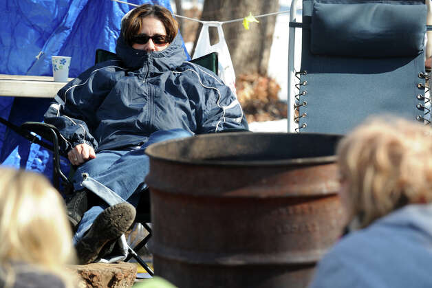 Berta Linarte sits near a fire in a makeshift strike camp set up near the West River Health Care Center, in Milford, Conn., Feb. 25th, 2013. Photo: Ned Gerard / Connecticut Post