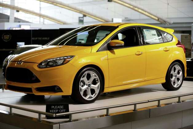 This Photo taken Feb. 14, 2013 shows the 2013 Ford Focus ST on display at the  2013 Pittsburgh Auto Show in Pittsburgh. (AP Photo/Gene J. Puskar) Photo: Gene J. Puskar, Associated Press / AP