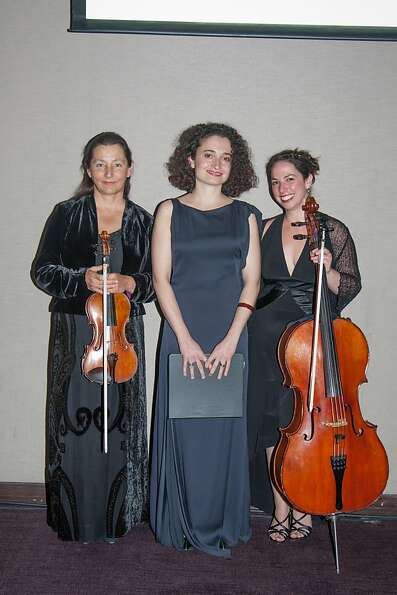 Performers pose for the camera at the Philharmonia Baroque Orchestra Winter Gala & Auction on Februa