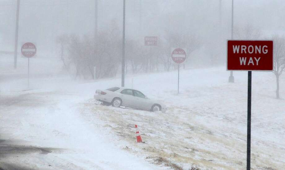 Don't say you weren't warned: Slick roadway claims a victim during a blizzard along Interstate 27 in Lubbock, Texas. The storm, which dumped snow across the Plains, brought hurricane-force winds to the Lone Star State. Photo: Zach Long, Associated Press