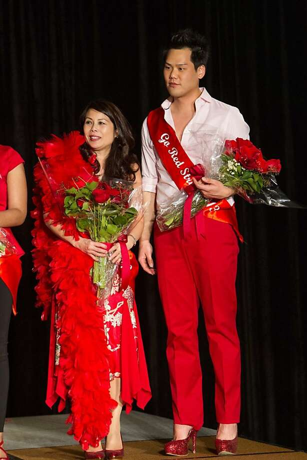 Sharon Seto savors her Best Female Strut victory with Best Male Strut winner Christopher Lee at the Go Red Strut benefit in San Francisco. Photo: Drew Altizer Photography