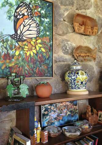 In this photo taken Feb. 16, 2013, a painting of a Monarch butterfly is displayed in the reception area of Rancho San Cayetano, a hotel near near Zitacuaro, in the central Mexican state of Michoacan. Visitors say San Cayetano is one of the nicest and most charming places to stay in butterfly country. It's also one of the priciest, but the manicured grounds are lush and the rooms are cozy, each with a fireplace and woodpile ready to light at night. (AP Photo/Marjorie Miller) Photo: Marjorie Miller, Associated Press / AP