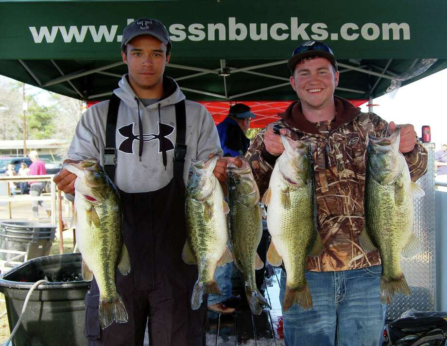 Cole Stewart and Andrew Golden holds up their 1st place limit weighing 27.51 lbs  Photo by Patty Lenderman, Lakecaster