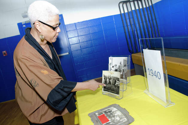 Anita Schmidt, of Norwalk, looks through Carver Center memorabilia during the 75th anniversary alumni reunion at the center in Norwalk on Friday, Feb. 22, 2013. Schmidt points to a photo from the 1940s which depicts her family at the ground breaking of the center at Quincy and Butler Streets in Norwalk. Photo: Amy Mortensen / Connecticut Post Freelance