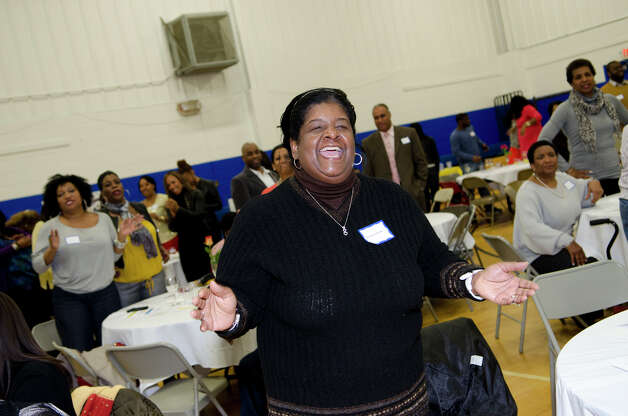 Brenda Penn Williams, of Norwalk, joyfully participates in a Carver Center cheer during the 75th anniversary alumni reunion at the Carver Center in Norwalk on Friday, Feb. 22, 2013. Williams attended the center in the 1970s. Photo: Amy Mortensen / Connecticut Post Freelance
