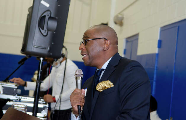 Master of Ceremonies, Erik Clemons, speaks during the 75th anniversary alumni reunion at the Carver Center in Norwalk on Friday, Feb. 22, 2013. Photo: Amy Mortensen / Connecticut Post Freelance