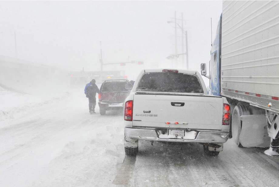 Traffic moves on the I-40 service road Monday, Feb. 25, 2013. A blizzard packing 50 mph wind gusts and more than 11 inches of snow blasted Amarillo and Texas Panhandle Monday, Feb. 25, 2013, making travel nearly impossible. Interstate 40 and many major highways in the Panhandle have been closed. (AP Photo/The Amarillo Globe News,Michael Schumacher) Photo: Michael Schumacher, Associated Press / Amarillo Globe-News