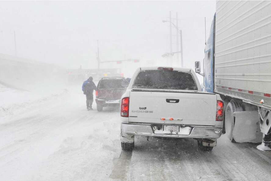 Traffic moves on the I-40 service road Monday, Feb. 25, 2013. A blizzard packing 50 mph wind gusts a