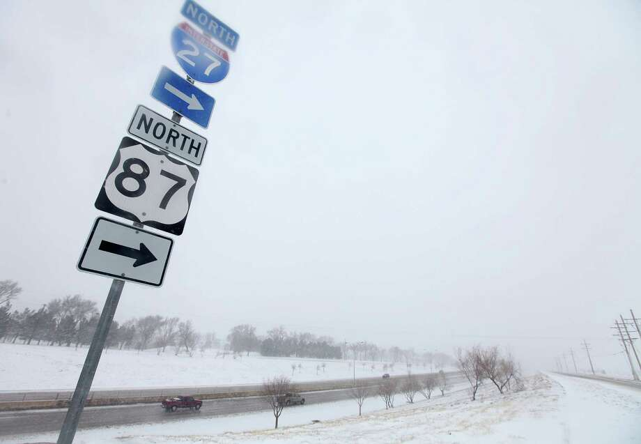 Vehicles navigate along Interstate 27 during blizzard conditions in Lubbock, Texas, Monday, Feb. 25, 2013. State troopers are unable to respond to calls for assistance and National Guard units are mobilizing as a winter storm blankets the central Plains with a foot of snow in some places. Roads are closed Monday throughout West Texas and the Panhandle. (AP Photo/Lubbock Avalanche-Journal, Zach Long) Photo: Zach Long, Associated Press / Lubbock Avalanche-Journal