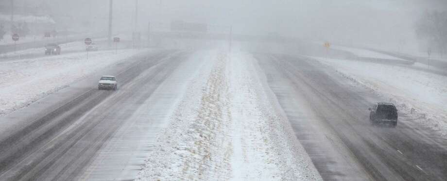 Cars move along the Marsha Sharp Freeway during blizzard conditions in Lubbock, Texas, Monday, Feb. 25, 2013. State troopers are unable to respond to calls for assistance and National Guard units are mobilizing as a winter storm blankets the central Plains with a foot of snow in some places. Roads are closed Monday throughout West Texas and the Panhandle. (AP Photo/Lubbock Avalanche-Journal, Zach Long) Photo: Zach Long, Associated Press / Lubbock Avalanche-Journal