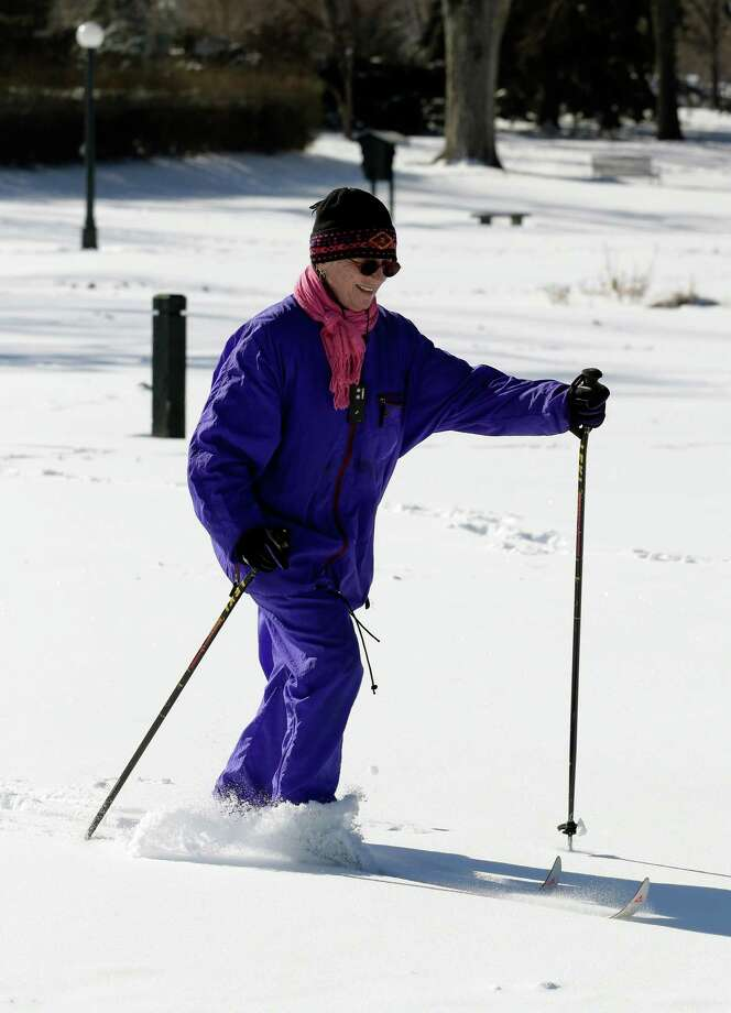 Eileen Hyatt works out on her cross county skis in Washington Park in Denver on Monday, Feb. 25, 2013. A winter storm passed through Colorado on Sunday dumping over a foot of snow in the Denver area.  (AP Photo/Ed Andrieski) Photo: Ed Andrieski, Associated Press / AP