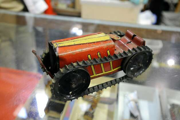 A '50's era, Marx brand, tin windup tractor is seen on display in the toy department.   The annual White Elephant Sale preview benefiting the Oakland Museum opened today to large crowds in Oakland, CA Sunday January 27th, 2013. Photo: Michael Short, Special To The Chronicle