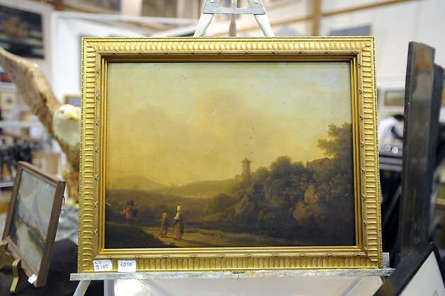 A landscape painting from the 1860's by the Belgian painter C. I. Biot is seen with a price of $2000.  The annual White Elephant Sale preview benefiting the Oakland Museum opened today to large crowds in Oakland, CA Sunday January 27th, 2013. Photo: Michael Short, Special To The Chronicle